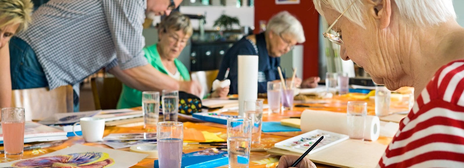 Senior woman water coloring class.