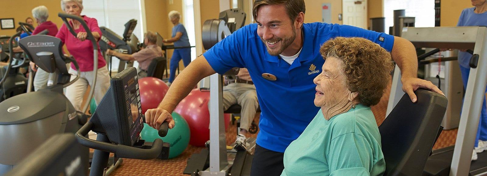 Senior women exercising in fitness center.