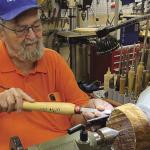 Senior man working on a lathe